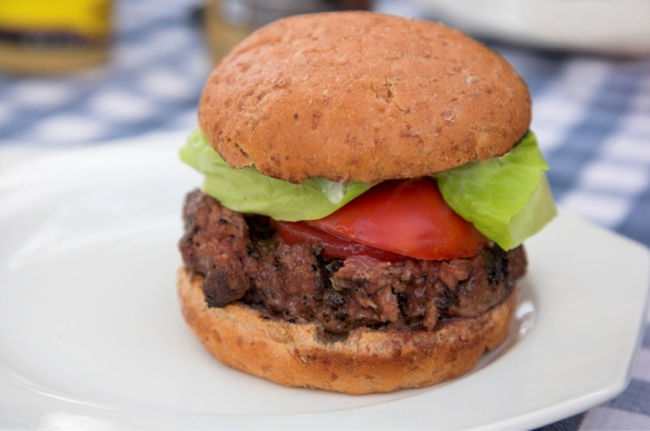 Hamburger on a plate sitting on a table