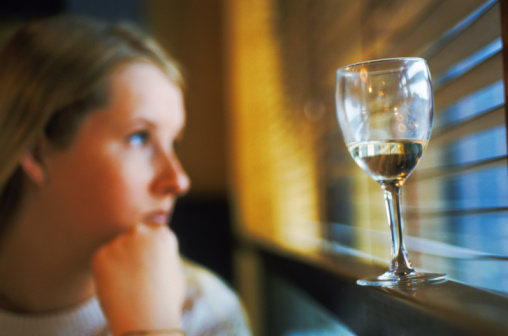 Woman and glass of wine
