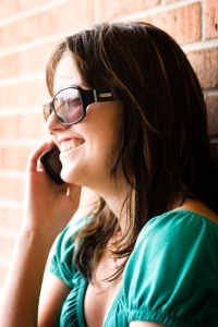 Girl talking on a cell phone, smiling